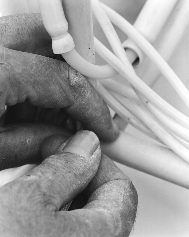 Theo Jansen's hands & plastic pipes (2010), Scheveningen beach, The Netherlands . Photo by Lena Herzog.